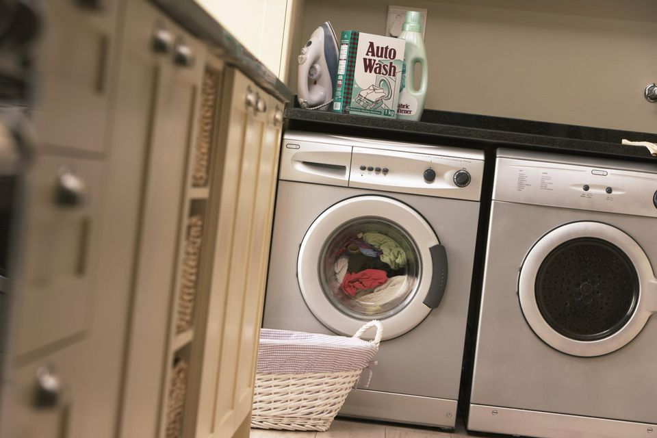 Laundry in washing machine in kitchen