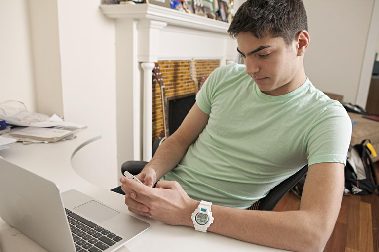 Set healthy limits on your teen's screen time.