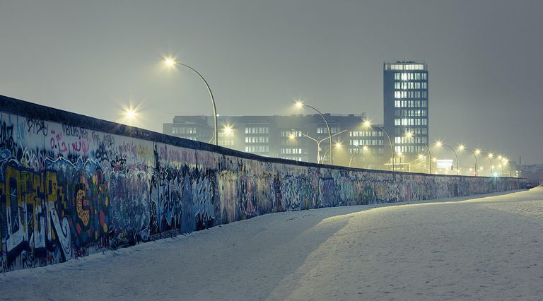 Berlin wall at winter with mist an nightlights