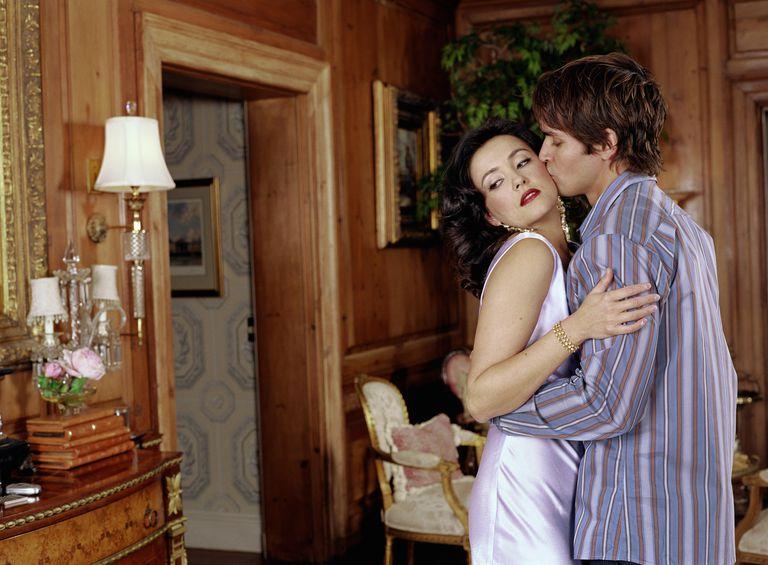 Couple embracing, man kissing woman on cheek