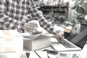 Shipping shopping online ,young start up small business owner writing address