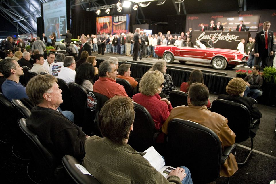 Audience watching auction at Barrett-Jackson Classic Car Auction.