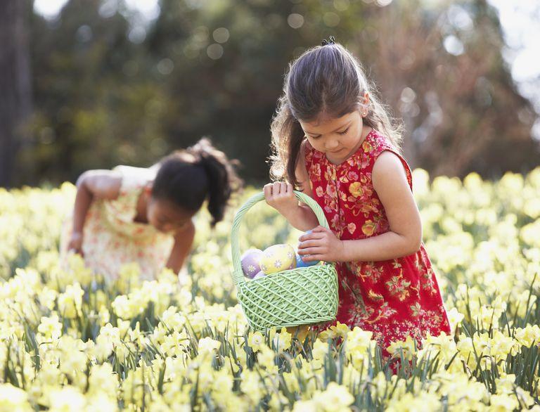 Multi-ethnic girls searching for Easter eggs