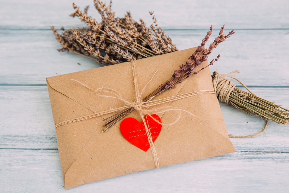 Envelope with heart sticker and dried flowers