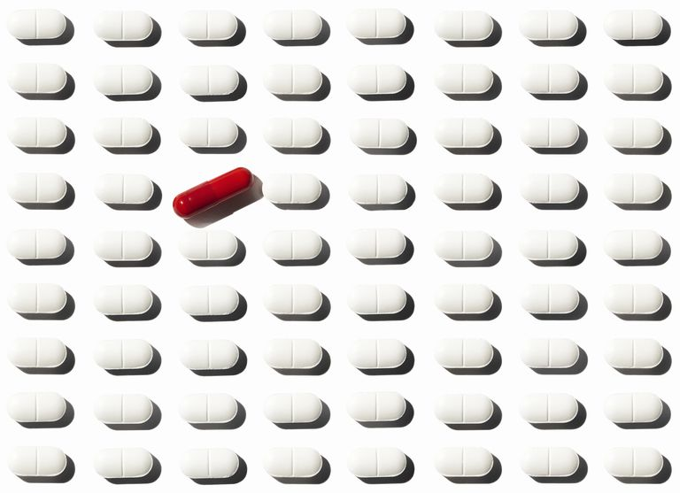 Grid of medicine with special drug standing out