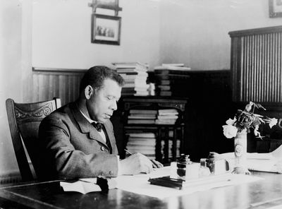 the contribution of booker t washington during the progressive era Though washington and du bois were both born in the same era, both  booker  t washington at his desk in the tuskegee institute, 1894.