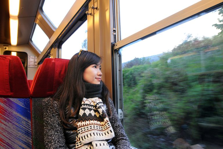 Girl in train observation car