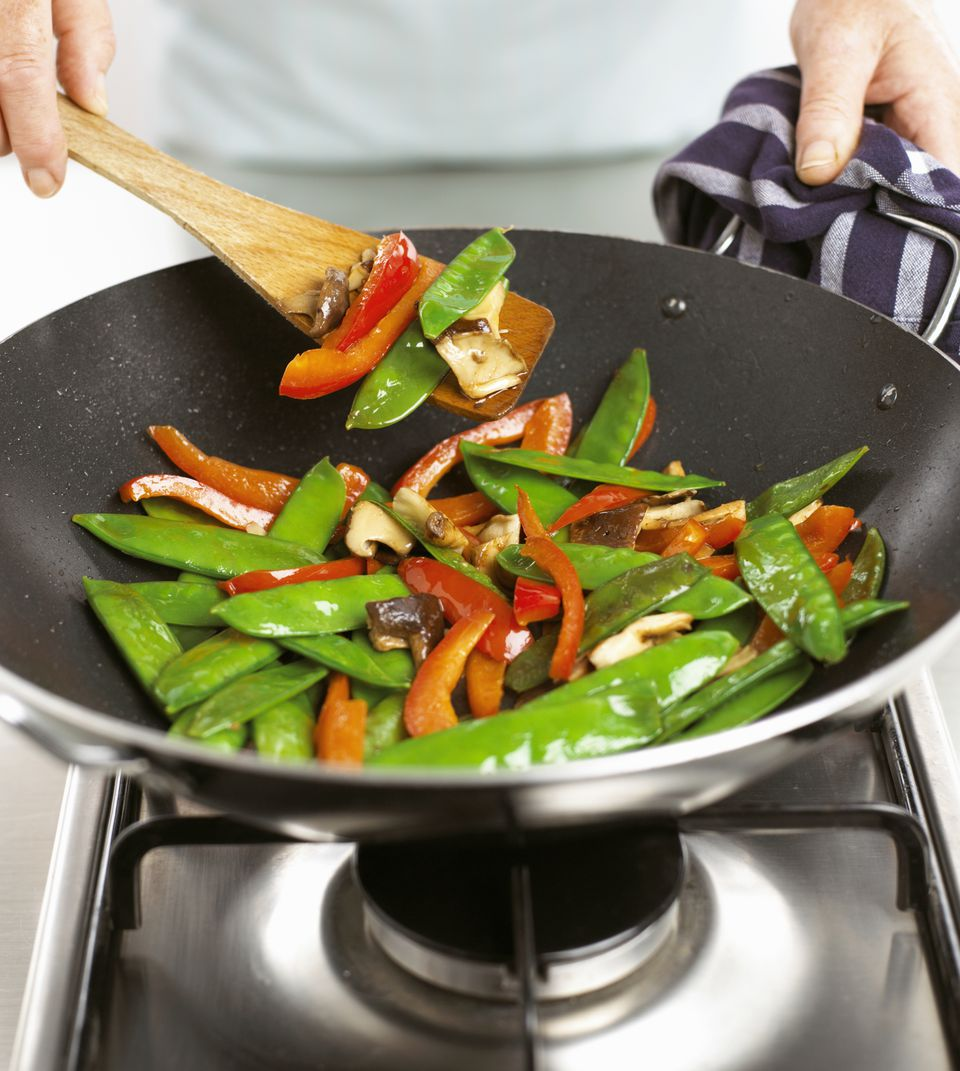 Sauteing vegetables in a wok