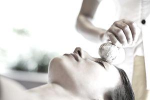 Woman receiving facial at spa