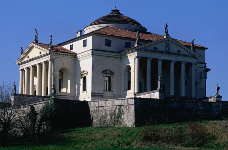 four-sided manor home with columned porticos on the sides and a dome in the center