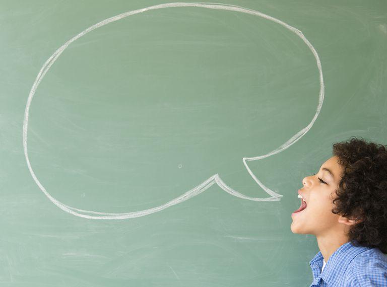 Speech bubble on chalkboard over student