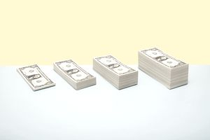 Stacks of US 1 dollar bills in ascending order