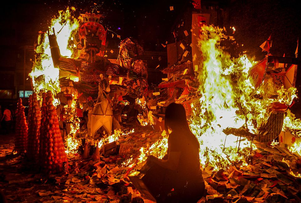Burning of hell money and other figures during Hungry Ghost Festival in Malaysia