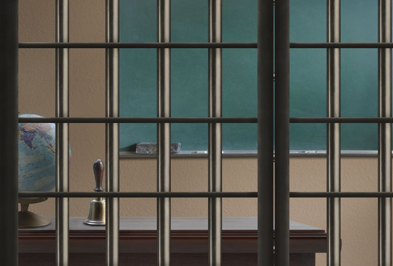 Illustration looking into a classroom through prison bars