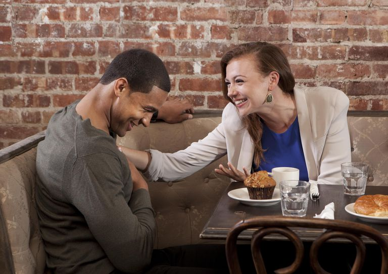 Couple laughing at coffee shop
