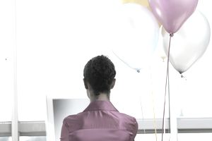 WomanonComputerwithBalloons-Getty-stk141191rke.jpg