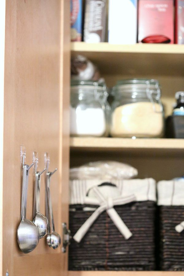 Mount measuring spoons on the inside of cabinets