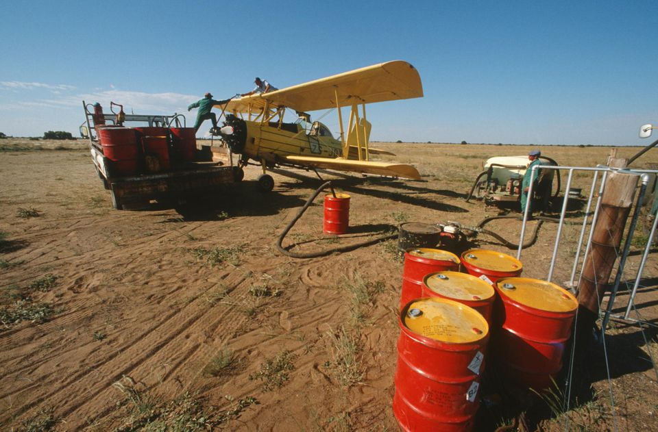 Spray aeroplane being filled with DDT insecticide. South Africa