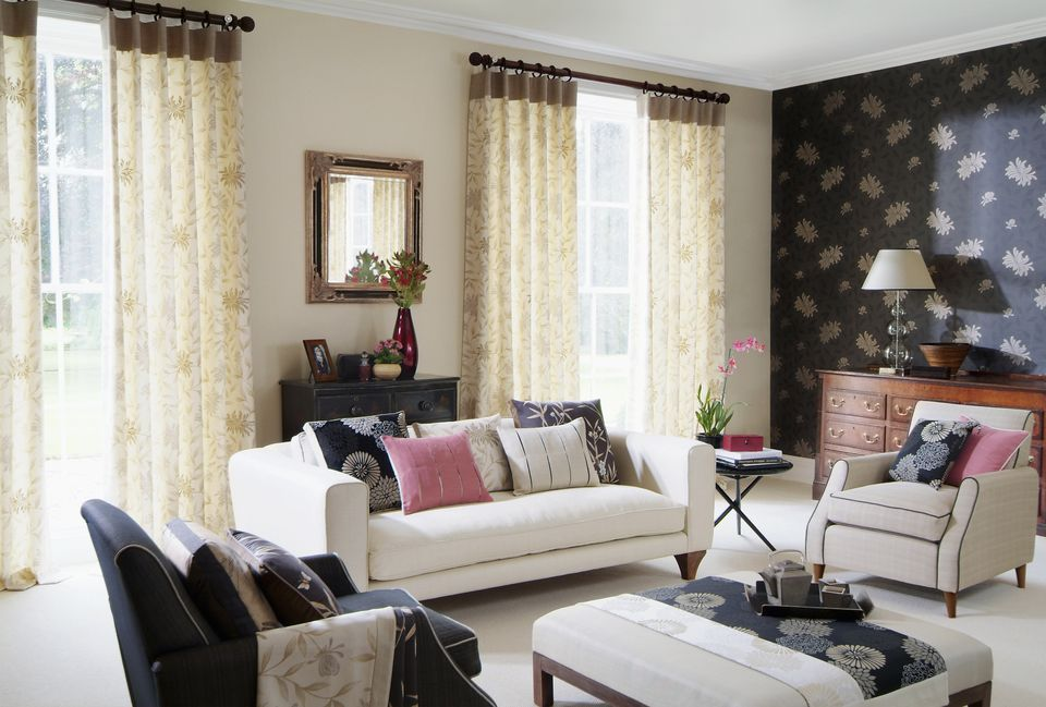 Interior of three seater sofa and chairs in living room