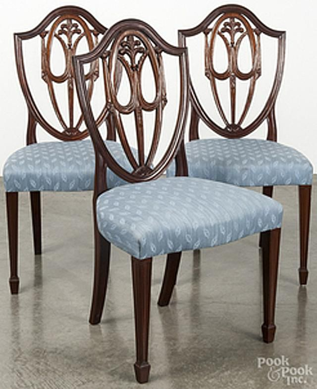 Hepplewhite style chairs with shield backs, squared legs and spade feet
