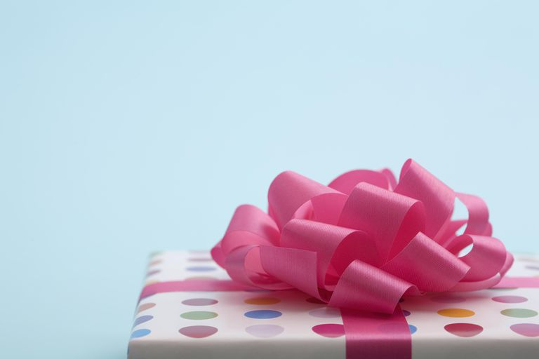Wrapped gift with pink bow, close up