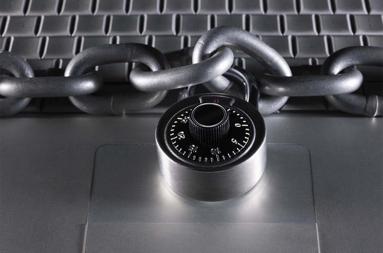 Chain and lock on laptop computer