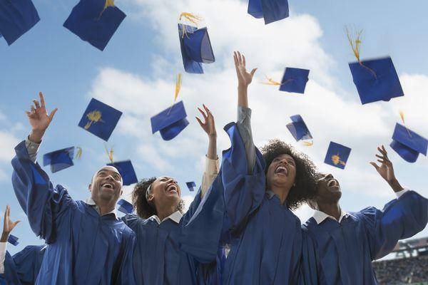 Students throwing caps at graduation