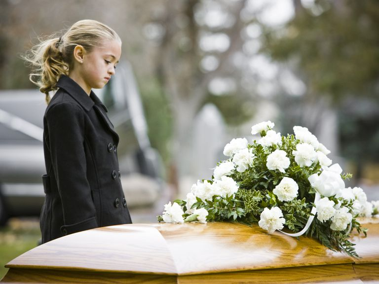 child at funeral