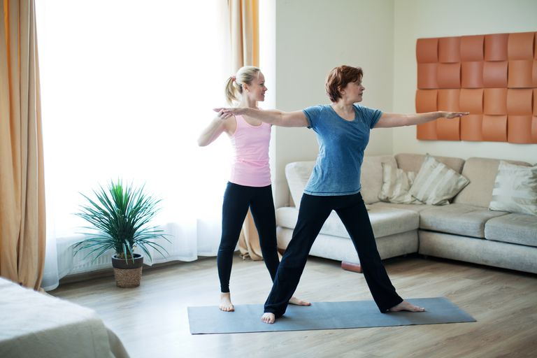 Older woman doing yoga at home