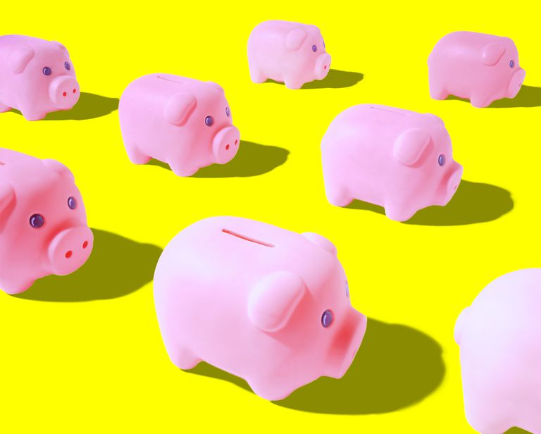 Pink piggy banks on yellow background (Digital Composite)
