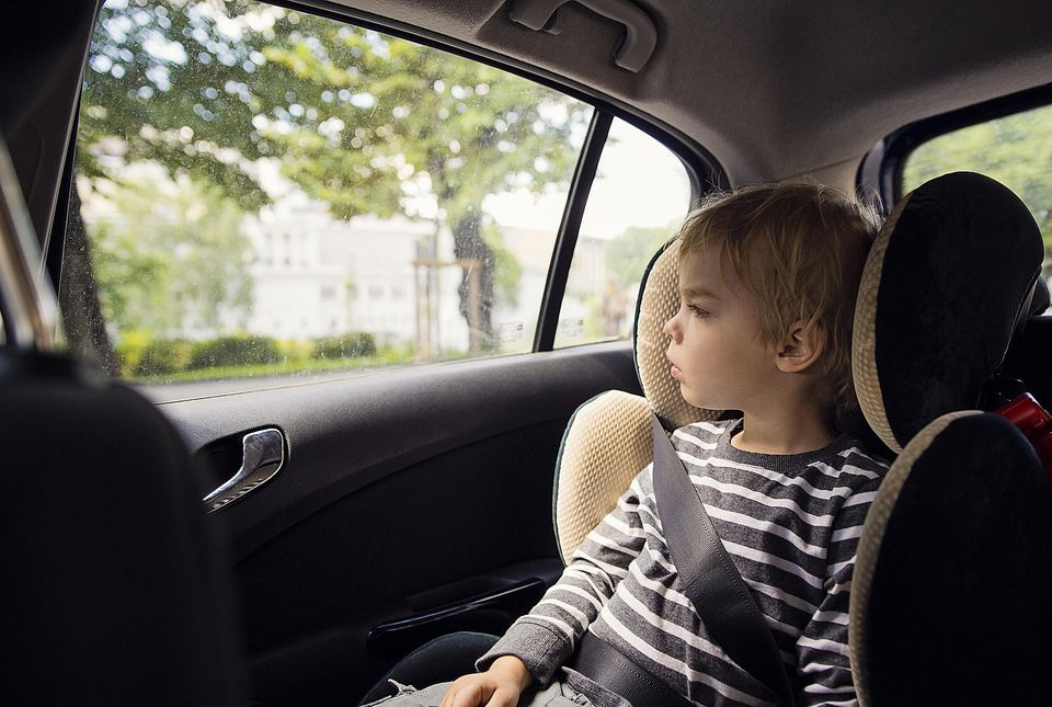 Toddler in car booster seat
