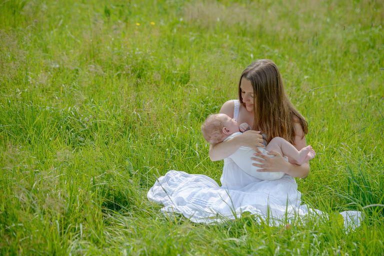Young woman lulling her baby son