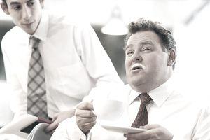 a businessman with a milk mustache