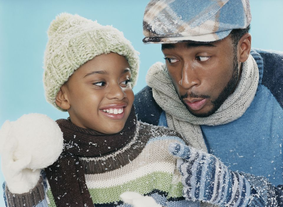 Portrait of a Man and His Young Son in Winter Clothing, Boy Pretending to Aim a Snowball at His Father