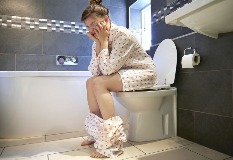 Teenager in pain on the toilet