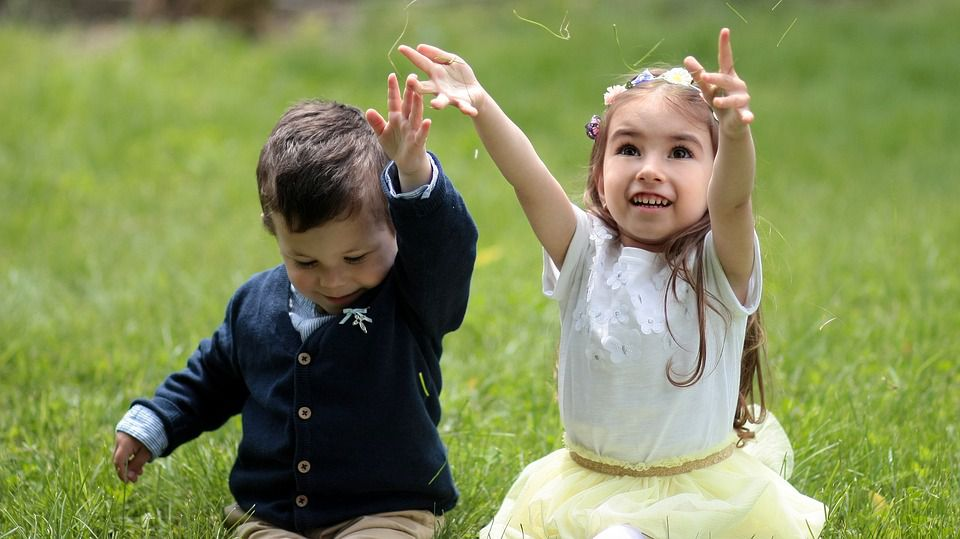 Boy and girl playing outside.