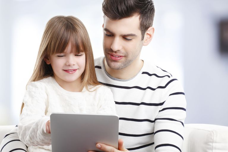 young girl and father on computer