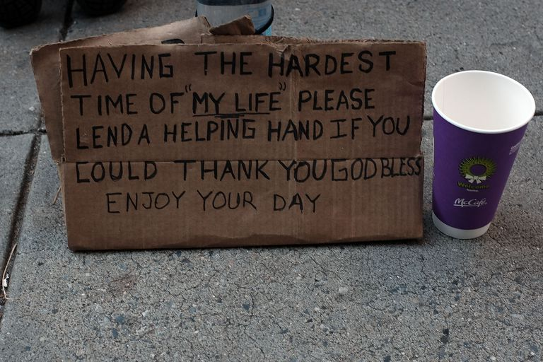 Homeless person's sign asking for donations