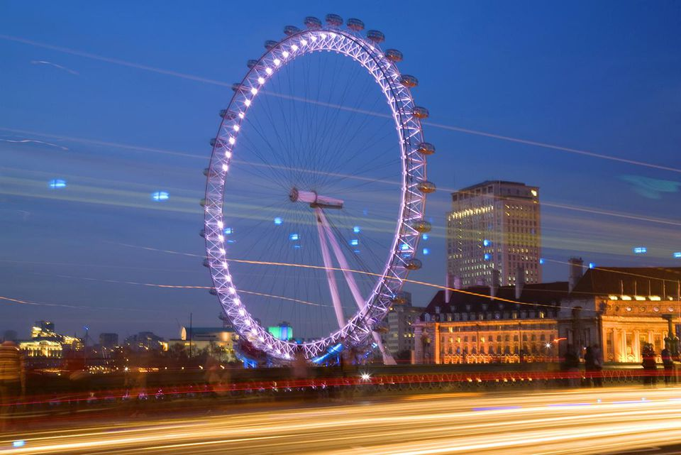 Evening view of London Eye, tourist attraction.