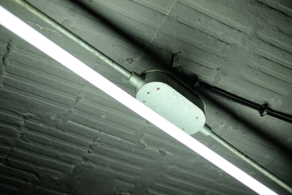 Low Angle View Of Fluorescent Light Mounted On Ceiling