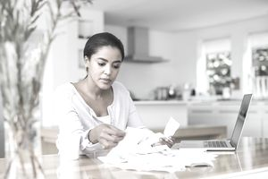 Woman sitting at table going through papers