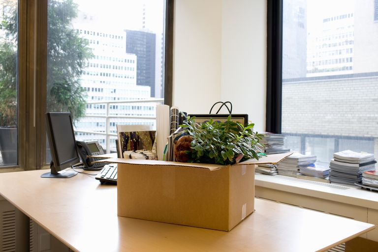 box of employee's personal items on office desk