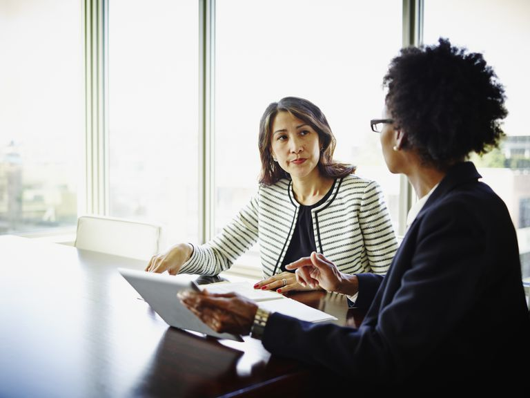 Woman interviewing potential candidate for job