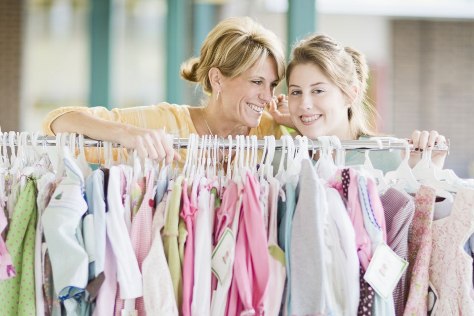 Mom and daughter buying clothes.