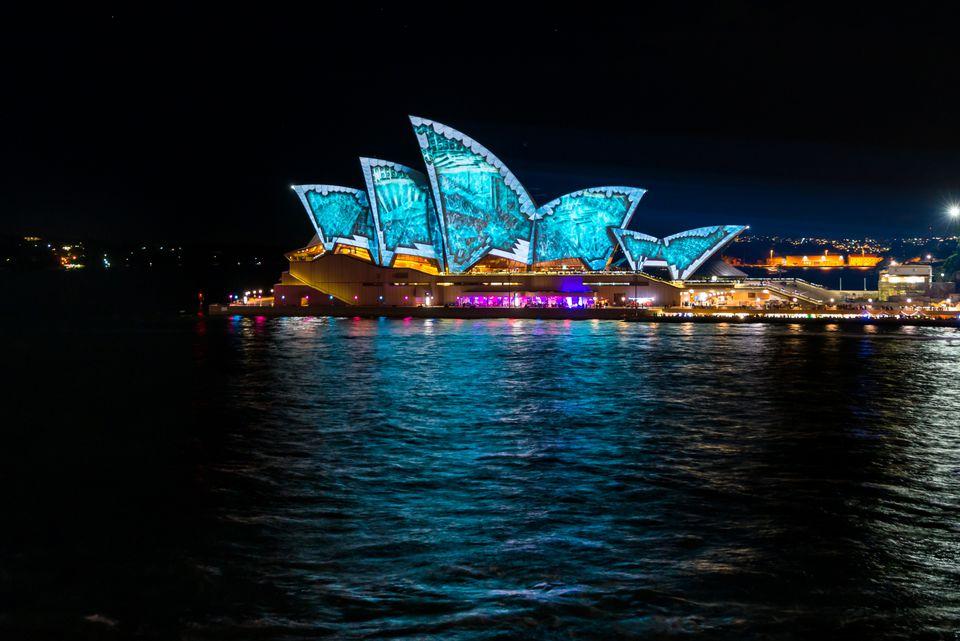 Sydney Opera House lit up at night