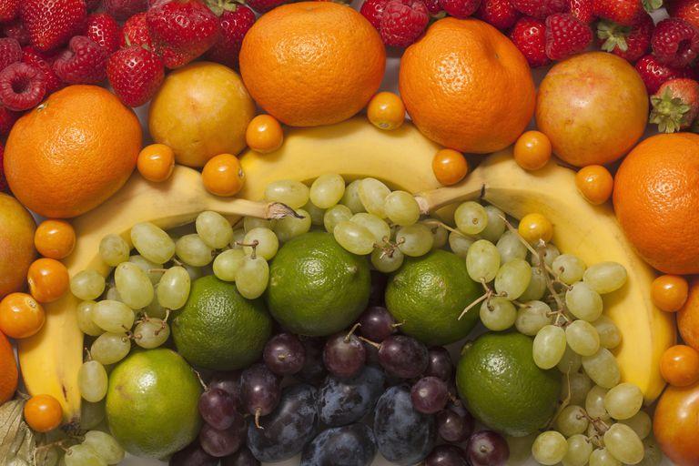 An abstract arrangement of various fresh fruits, full frame
