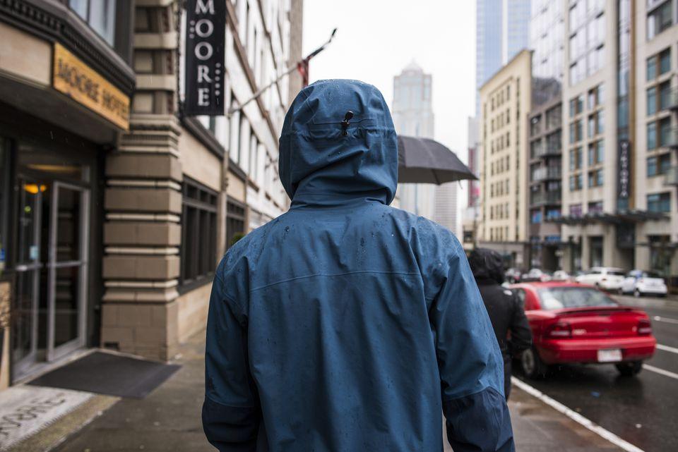 person wearing raincoat on Seattle street