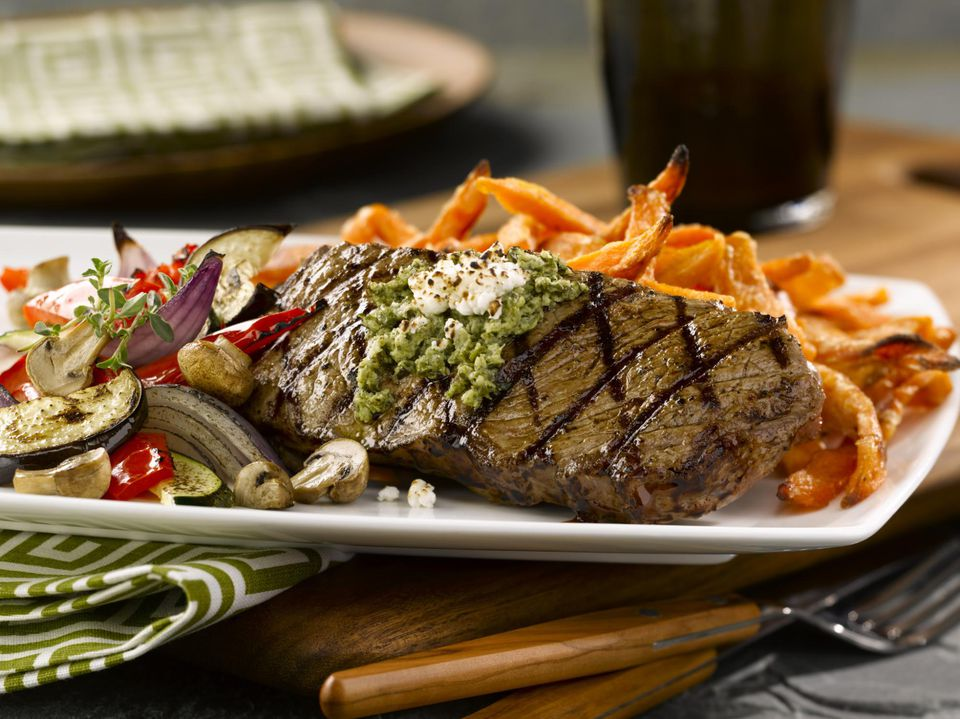 steak with vegetables and French fries