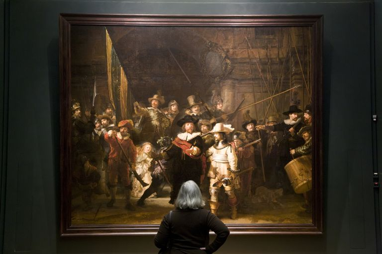 woman looking at Rembrandt painting