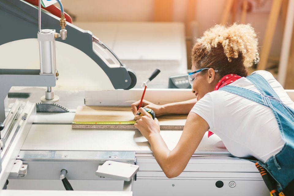 Latina Carpenter Working In Her Workshop